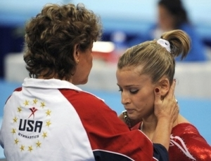 Alicia Sacramone is consoled by U.S. National Team Coordinator Martha Karolyi after a disappointing performance during the women's team final in Beijing Tuesday night.
