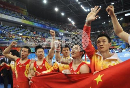 The Chinese men's team reacts to winning the team competition in Beijing.