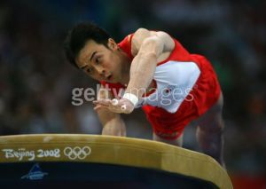 Japan's Takehiro Kashima vaults during the Olympic team finals. Japan was a distant second behind China.